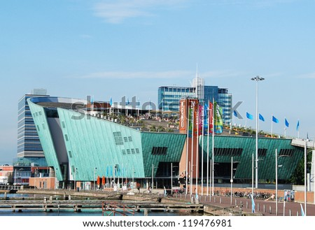 AMSTERDAM, NETHERLANDS - AUGUST 20: The Nemo Museum on Aug 20, 2012 in Amsterdam, Netherlands. Science Center NEMO is a science center designed by Renzo Piano since 1997. - stock photo