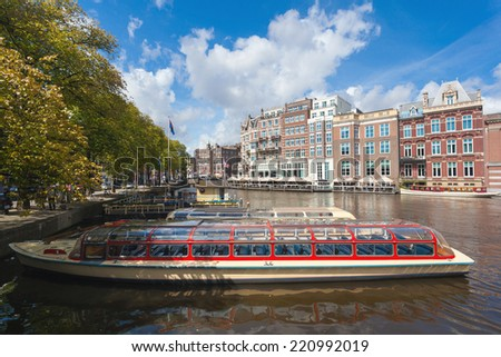 AMSTERDAM - NETHERLANDS: AUGUST 14, 2014: Tourist city sightseeing boat in the canal. - stock photo
