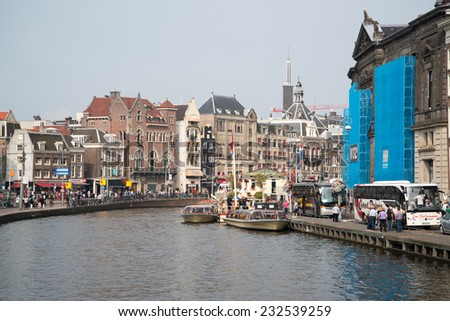 AMSTERDAM, NETHERLANDS - CIRCA SEPTEMBER 2014: Tourist visiting capital of Holland Amsterdam. - stock photo