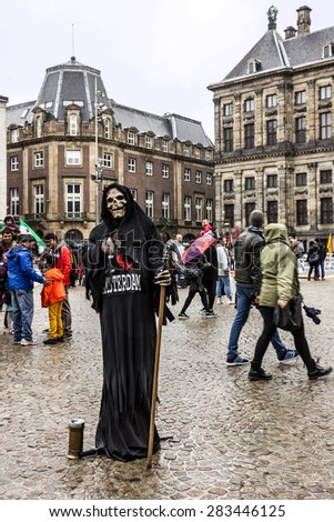 Amsterdam, Netherlands, Dam Square - Death alive figure and people on the street - stock photo
