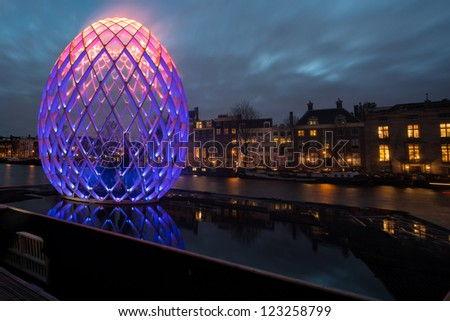 AMSTERDAM, NETHERLANDS - DEC 29: Piece of light art at night during the Amsterdam Light festival in Amsterdam, the Netherlands on December 29, 2012 - stock photo