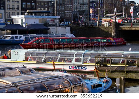 Amsterdam,Netherlands â?? December 23, 2015 : Amsterdam sightseeing boat tour during Christmas. - stock photo