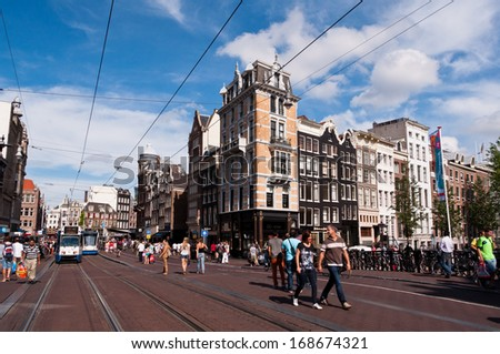 AMSTERDAM, NETHERLANDS - JULY 27, 2013: Common view of streets of Amsterdam in summer of 2013. - stock photo