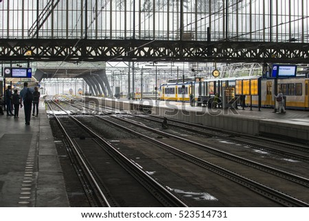 AMSTERDAM, NETHERLANDS - JULY 8, 2015: Detail of the platforms and train tracks at the central station of the city.