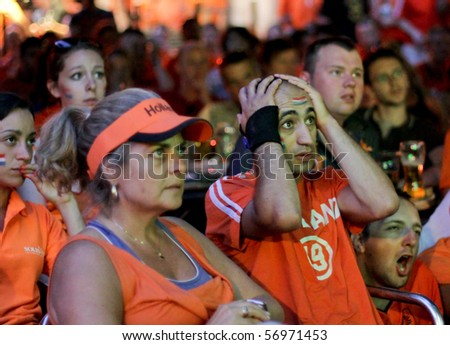 AMSTERDAM, NETHERLANDS - JULY 11: Football fans in Amsterdam on 19th FIFA World Cup 2010 Final The Netherlands - Spain, on July 11, 2010 in Amsterdam, Netherlands.