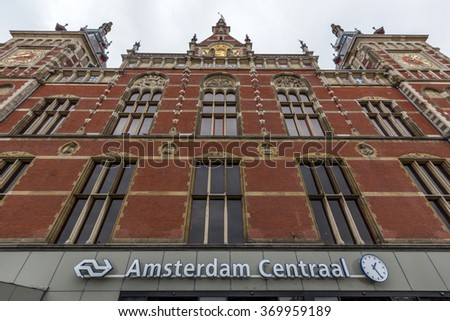 AMSTERDAM, NETHERLANDS - JULY 29, 2015: Front view of Station Amsterdam Centraal. It is the largest railway station of Amsterdam, Netherlands, and a major national railway hub. - stock photo
