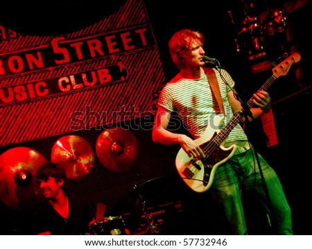 AMSTERDAM, NETHERLANDS - JULY 14: Marco Cinelli Trio live at Bourbon Street Music club  on July 14, 2010 in Amsterdam, Netherlands. - stock photo
