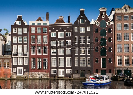 AMSTERDAM, NETHERLANDS - JULY 13: The canal houses of Amsterdam on July 13, 2013. Amsterdam is the capital city and most populous city of the Kingdom of the Netherlands.