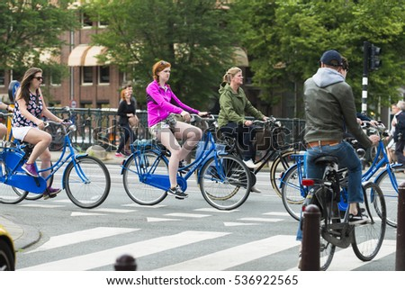 AMSTERDAM, NETHERLANDS - JULY 8, 2015: Very dense traffics, bicycles only one of the streets of the city.