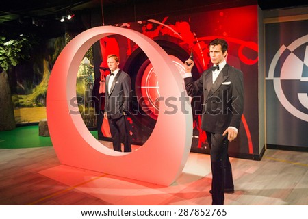 AMSTERDAM, NETHERLANDS - JUN 1, 2015: Daniel Craig and Pierce Brosnan as the agent 007 James Bond in Madame Tussauds museum in Amsterdam. Marie Tussaud was born as Marie Grosholtz in 1761 - stock photo