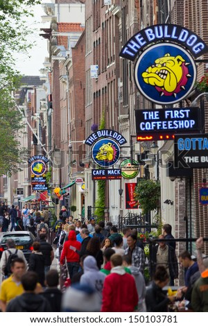 AMSTERDAM, NETHERLANDS - JUN 23: 3 The Bulldog coffeeshops in Amsterdam on Jun 23, 2013 Amsterdam, Netherlands. Bulldog was the first coffeshop and laid the benchmark for the contemporary coffeeshop. - stock photo