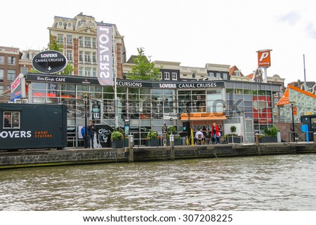Amsterdam, Netherlands - June 20, 2015: Berth excursion ships on the waterfront in Amsterdam - stock photo
