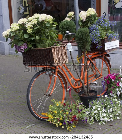Amsterdam,netherlands-june 3, 2015: bicycle decorated with flowers in the streets of Amsterdam