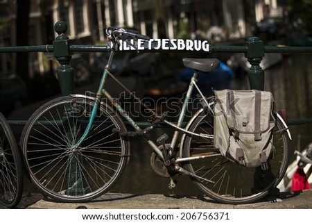 Amsterdam, Netherlands - June 29: Bicycles in the city of Amsterdam, Netherlands on June 29, 2014. The locals use the bicycle as a preferred method of transportation. - stock photo