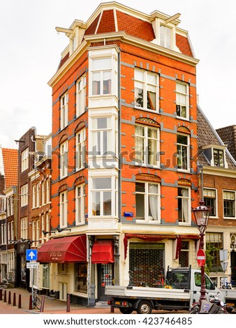 AMSTERDAM, NETHERLANDS - JUNE 1, 2015: Colorful architecture of Amsterdam, Netherlands. Amsterdam is the capital of Netherlands and a popular touristic destination