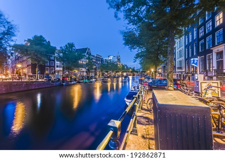 AMSTERDAM, NETHERLANDS - JUNE 15, 2013: Keizersgracht canal, one of the tree main and most transitated canals in Amsterdam, Netherlands. - stock photo