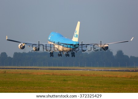 AMSTERDAM, NETHERLANDS - JUNE 5, 2014: KLM Boeing 747-400 PH-BFH landing at Schiphol airport.
