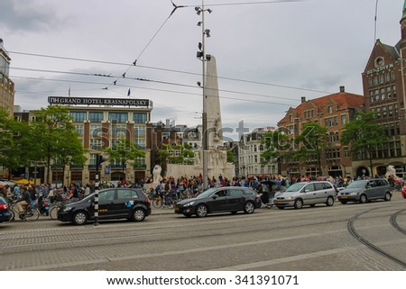 Amsterdam, Netherlands - June 20, 2015: People on the Dam Square in Amsterdam . Netherlands