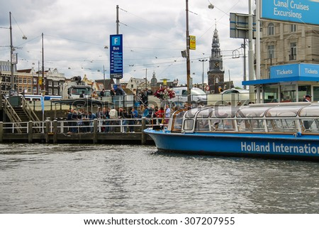Amsterdam, Netherlands - June 20, 2015: People on the dock landing on river cruise ships, Amsterdam, Netherlands - stock photo