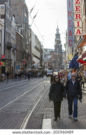 Amsterdam, Netherlands - June 30: People on the streets of Amsterdam, Netherlands on June 30, 2014. Amsterdam is the capital city of The Netherlands