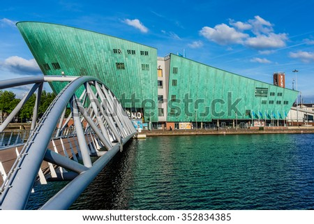 AMSTERDAM, NETHERLANDS - JUNE 17, 2014: Science Center NEMO designed by Renzo Piano (1997) - largest childrens science educational museum, knowledge institute and center of tourism in Netherlands. - stock photo