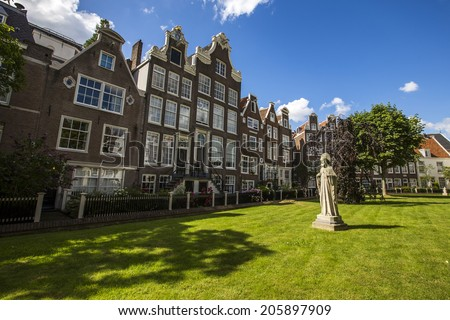 Amsterdam, Netherlands - June 30: View of the Begijnhof quarter in Amsterdam, Netherlands on June 30, 2014. The Begijnhof is one of the oldest inner courts in the city of Amsterdam.