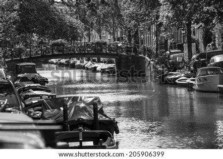 Amsterdam, Netherlands - June 30: Water canals of Amsterdam, Netherlands, on June 30, 2014.