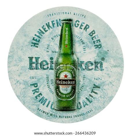 AMSTERDAM, NETHERLANDS - MARCH 15, 2015: Beermat of Dutch beer Heineken isolated over white background - stock photo