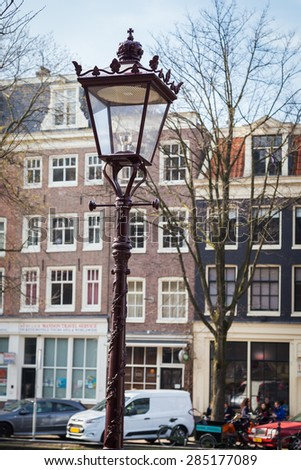 AMSTERDAM, NETHERLANDS - MARCH 16: Canal and houses in Amsterdam. Amsterdam is the capital and most beautiful city of the Netherlands on March 16, 2014
