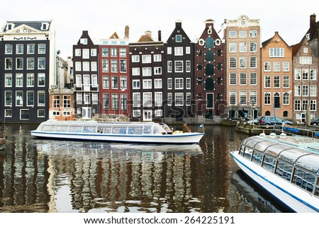 Amsterdam, Netherlands - March 2015: the landscape of the city canals - stock photo