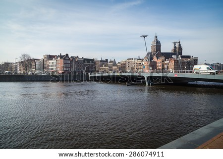 AMSTERDAM, NETHERLANDS - MARCH 16: View of Amsterdam. Amsterdam is the capital and most beautiful city of the Netherlands on March 16, 2014 - stock photo