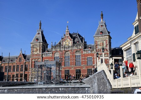 AMSTERDAM, NETHERLANDS - MAY 6, 2016:Amsterdam Central Train Station in Amsterdam, Netherlands .Every day 250,000 go through Amsterdam's Central Station.