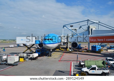 Amsterdam, Netherlands - May 16, 2015: KLM Plane at Schiphol Airport on May 16, 2015 in Amsterdam, Netherlands. The airport handles over 45 million passengers per year with almost 100 airlines. - stock photo