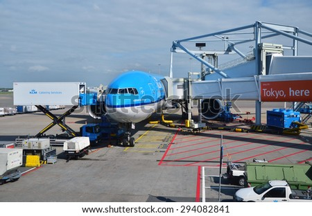 Amsterdam, Netherlands - May 16, 2015: Plane at Schiphol Airport on May 16, 2015 in Amsterdam, Netherlands. The airport handles over 45 million passengers per year  - stock photo