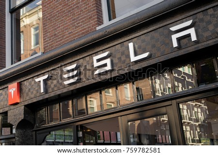 AMSTERDAM, NETHERLANDS - November 6, 2017: Tesla Sign Outside of Tesla Motors Store in Amsterdam.