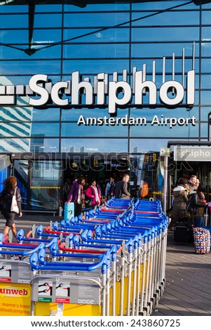 AMSTERDAM, NETHERLANDS - NOVEMBER 08: The main entrance of Amsterdam Airport Schiphol on November 08, 2014 in Amsterdam, Netherlands. It is the Netherlands' main international airport. - stock photo