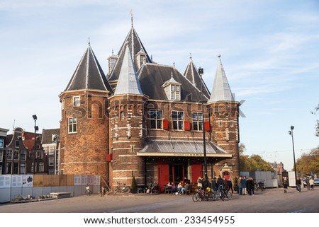 AMSTERDAM, NETHERLANDS - NOVEMBER 13: The Waag with unidentified people on November 13, 2014 in Amsterdam. From 15th century The Waag is the oldest remaining non-religious building in Amsterdam. - stock photo