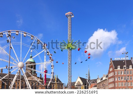 AMSTERDAM, NETHERLANDS, October, 10 - Attractions autumn park on Dam Square  (Royal Square) of Amsterdam.  Amsterdam, Netherlands, October 10, 2014 - stock photo