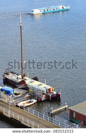 AMSTERDAM, NETHERLANDS - OCTOBER 09, 2014 : Mooring of the tourist and housing ships top view on Oosterdok in Amsterdam-Centrum. Netherlands  - stock photo