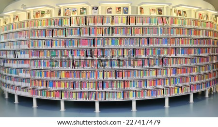 AMSTERDAM, NETHERLANDS - OCTOBER 09: Shelves with video disks in Central Public Library of Amsterdam on October 09, 2014. The library is the biggest of all public libraries of the Netherlands - stock photo
