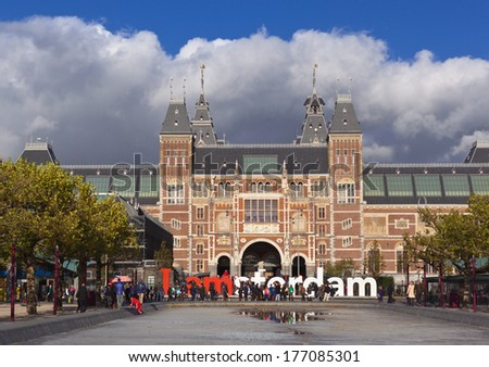 AMSTERDAM, NETHERLANDS - October,17, 2013: The Rijksmuseum with the words IAMSTERDAM. The museum first opened to the public in 1800,famous for its collection of 17th century masters,center of tourism. - stock photo