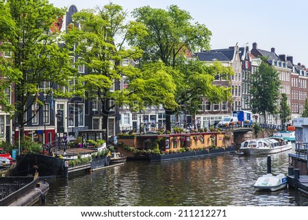 Amsterdam, Netherlands, on July 10, 2014. Inhabited boats at the channel coast