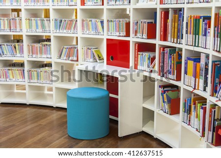 AMSTERDAM, NETHERLANDS on MARCH 28, 2016. Books on racks in a reading room in public library of Amsterdam - stock photo