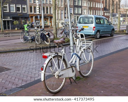 AMSTERDAM, NETHERLANDS on MARCH 27, 2016. City landscape. The bicycle parking  in the street