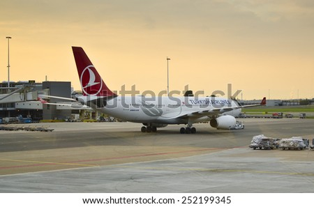 AMSTERDAM, NETHERLANDS - SEPTEMBER 27: a Turkish Airlines Airbus A330 on September 27, 2014 at Schiphol Airport, Amsterdam, Netherlands. Turkish Airlines has over 18,000 employees and a fleet of 261. - stock photo