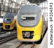 AMSTERDAM, NETHERLANDS - SEPTEMBER 22: Passenger Trains NS Intercity on September 22, 2011 in Amsterdam Central Station. Nederlandse Spoorwegen is the largest rail transport operator in NL. - stock photo