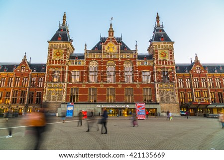 AMSTERDAM, NETHERLANDS - 16TH FEBRUARY 2016: The outside of Amsterdam Centraal station during the day. The blur of people can be seen. - stock photo