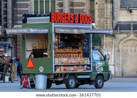 Amsterdam, Noord-Holland/Netherlands -January 08-01-2016 - Dutch Burgers & Dogs stand parked at the Damrak in the city of Amsterdam.  - stock photo