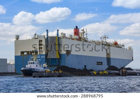 Amsterdam, Noord-Holland/Netherlands - June 15-06-2015 - Sapphire Ace Vehicles Carrier registered at Panama is underway using engine. Tugboat Arion is connected for push/pull assistance.