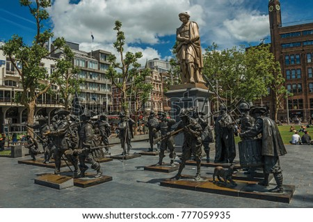 Amsterdam, northern Netherlands - June 26, 2017. Rembrandt Square with sculptural reproduction in bronze from the Night Watch picture. Famous for its huge cultural activity, graceful canals and bridge